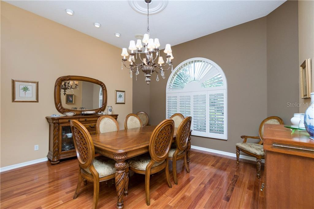 Beautiful formal dining area! Note the plantation shutter. The hardwood floor has been changed to tile. - Single Family Home for sale at 280 Capstan Dr, Placida, FL 33946 - MLS Number is D6113118