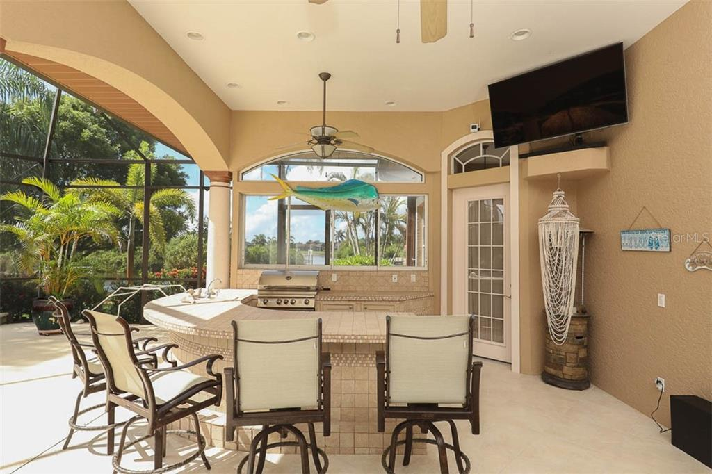 Outdoor Kitchen - Single Family Home for sale at 9300 Hialeah Ter, Port Charlotte, FL 33981 - MLS Number is D6113597