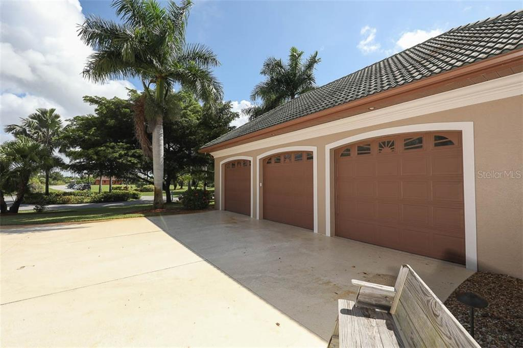 3.5 Car Garage With Workshop - Single Family Home for sale at 9300 Hialeah Ter, Port Charlotte, FL 33981 - MLS Number is D6113597