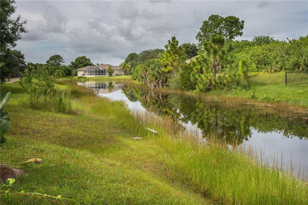 Fish from your own backyard! - Single Family Home for sale at 185 Apollo Dr, Rotonda West, FL 33947 - MLS Number is D6113690