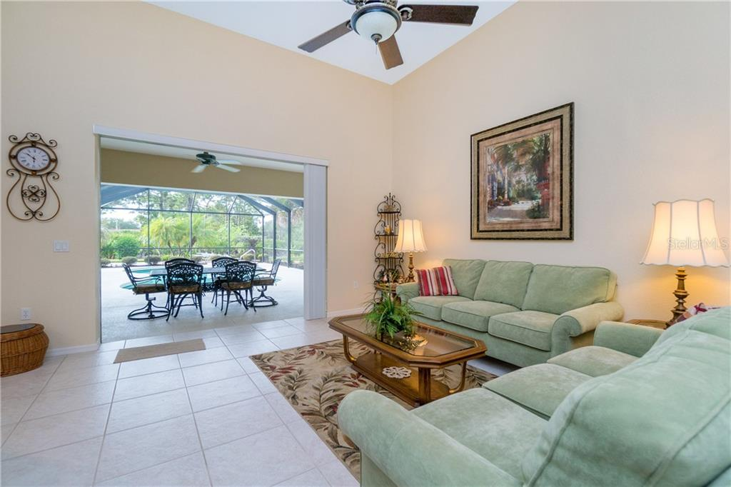 View from the formal living room to the lanai area. - Single Family Home for sale at 439 Boundary Blvd, Rotonda West, FL 33947 - MLS Number is D6114162