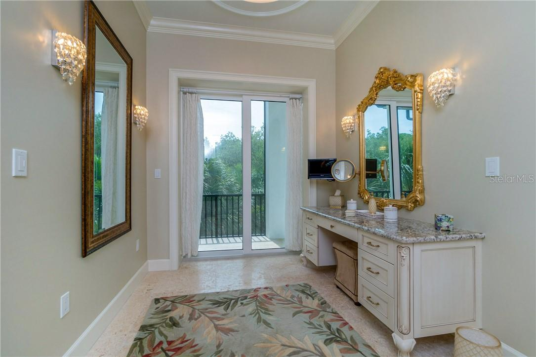 Mini chandelier lighting adds the perfect feminine touch to this powder room - Single Family Home for sale at 10161 Eagle Preserve Dr, Englewood, FL 34224 - MLS Number is D6114216