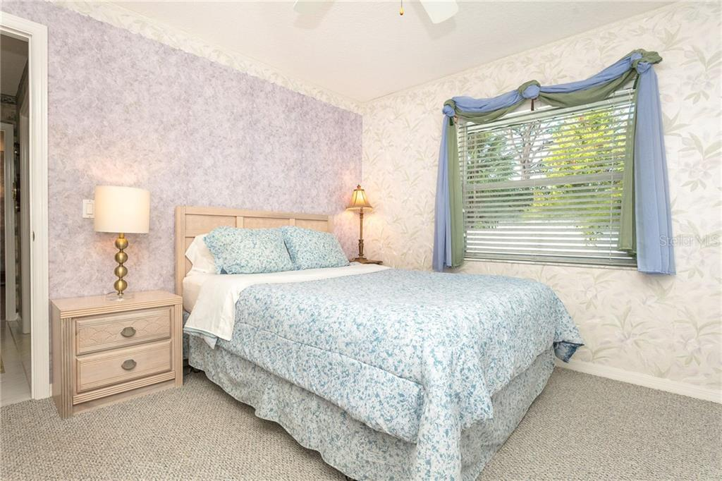 Bedroom 2 - Single Family Home for sale at 1720 Larson St, Englewood, FL 34223 - MLS Number is D6114414