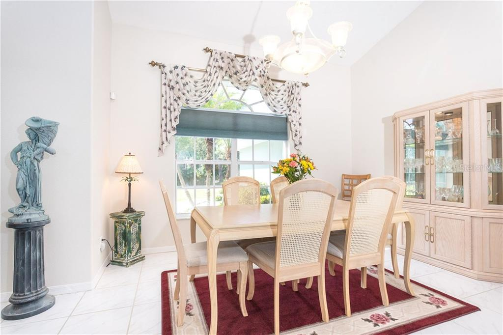 Large dining area offers lots of room for hosting family and friends - Single Family Home for sale at 1720 Larson St, Englewood, FL 34223 - MLS Number is D6114414