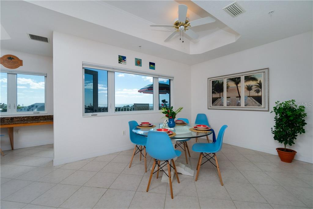 Large Dining Space in the Kitchen Looking to the Gulf - Condo for sale at 2225 N Beach Rd #401, Englewood, FL 34223 - MLS Number is D6114646