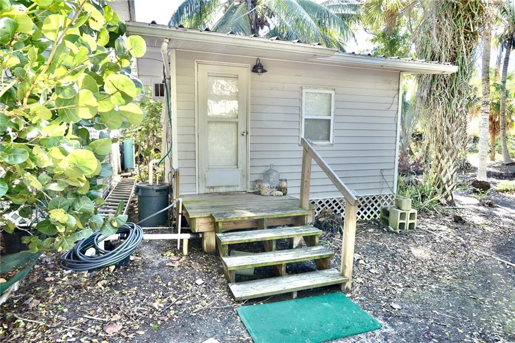 There is an additional Guest House at the rear of the main house. - Single Family Home for sale at 8144 Little Gasparilla Is, Placida, FL 33946 - MLS Number is D6115518