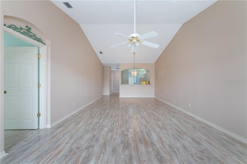 Dining room/living room combo - Villa for sale at 849 Tartan Dr #10, Venice, FL 34293 - MLS Number is D6115682