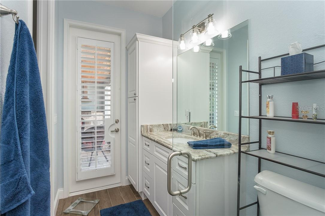 Bathroom 3 with direct access to the lanai - Single Family Home for sale at 145 Leland St Se, Port Charlotte, FL 33952 - MLS Number is D6117438