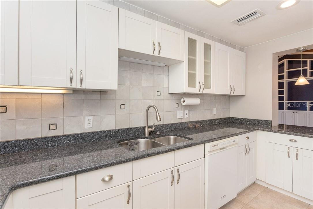 Neutral Backsplash that compliments the style of this gorgeous home - Single Family Home for sale at 1661 New Point Comfort Rd, Englewood, FL 34223 - MLS Number is D6117712