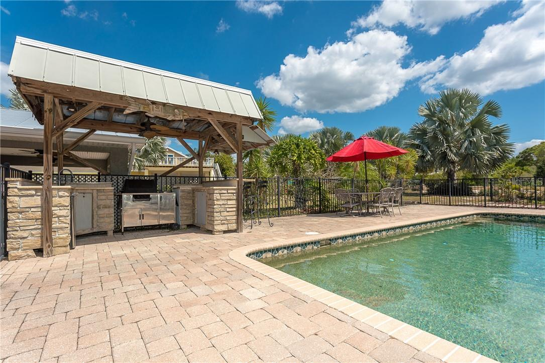2 Outside Kitchen for this home - this one near the pool area that has everything built into what you need for entertaining and covered in case the weather should change - Single Family Home for sale at 1661 New Point Comfort Rd, Englewood, FL 34223 - MLS Number is D6117712
