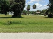 View of the lots from Langsner St. - Vacant Land for sale at Langsner St, Englewood, FL 34223 - MLS Number is D5917047