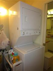 Inside Utility room has stacking washer/dryer set. - Condo for sale at 6796 Gasparilla Pines Blvd #14, Englewood, FL 34224 - MLS Number is D5919892
