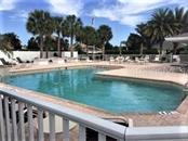 Oak Forest Swimming Pool - Villa for sale at 1116 Yosemite Dr, Englewood, FL 34223 - MLS Number is D6100080