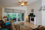 Living Area Opens to Lanai - Single Family Home for sale at 222 Westwind Dr, Placida, FL 33946 - MLS Number is D6100545