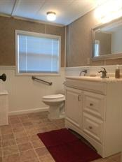 Updated  bathroom with new vanity and fixtures. - Single Family Home for sale at 1372 Ibis Dr, Englewood, FL 34224 - MLS Number is D6100727