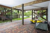 pavered carport with plenty of room for golf cart parking and could also be used as extra entertaining space. - Single Family Home for sale at 43 Bayshore Cir, Placida, FL 33946 - MLS Number is D6101722
