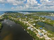 Aerial From Gulf of Mexico - Single Family Home for sale at 121 Bocilla Dr, Placida, FL 33946 - MLS Number is D6102584