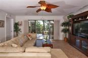 Living Area Opens to Covered Balcony - Condo for sale at 50 Meredith Dr #8, Englewood, FL 34223 - MLS Number is D6103644