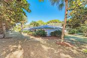 No shortage of shade in this tropical luxury retreat. - Single Family Home for sale at 7400 Manasota Key Rd, Englewood, FL 34223 - MLS Number is D6104362