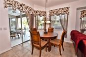 Dinette with sliding doors to the Lanai and pool area. - Single Family Home for sale at 8 Medalist Cir, Rotonda West, FL 33947 - MLS Number is D6104474