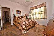 Gues bedroom 1. - Single Family Home for sale at 8 Medalist Cir, Rotonda West, FL 33947 - MLS Number is D6104474