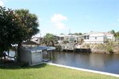 This waterfront home is only two bridges to Lemon Bay and has a new seawall. - Manufactured Home for sale at 1316 Seagull Dr, Englewood, FL 34224 - MLS Number is D6105776