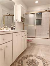 GUEST BATHROOM - Single Family Home for sale at 7036 S Lake Dr, Englewood, FL 34224 - MLS Number is D6107032