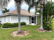 SIDE VIEW OF BACK - Single Family Home for sale at 7036 S Lake Dr, Englewood, FL 34224 - MLS Number is D6107032