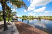 70' x 8' composite dock - Single Family Home for sale at 15052 Aquarius Cir, Port Charlotte, FL 33981 - MLS Number is D6108637