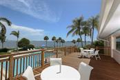 Enjoy a refreshing beverage on the deck overlooking pool & Intracoastal - Condo for sale at 11000 Placida Rd #2501, Placida, FL 33946 - MLS Number is D6112229