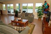 Another view of the living room & water views - Condo for sale at 2245 N Beach Rd #304, Englewood, FL 34223 - MLS Number is D6112346