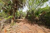 pathway thru property - Vacant Land for sale at 9427 Downing St, Englewood, FL 34224 - MLS Number is D6112667