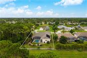 Aerial view 5 - Single Family Home for sale at 439 Boundary Blvd, Rotonda West, FL 33947 - MLS Number is D6114162