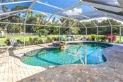 Relax in your private oasis as you listen to the sound of your own waterfall - Single Family Home for sale at 1720 Larson St, Englewood, FL 34223 - MLS Number is D6114414