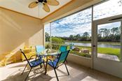 Lanai with view of brick  paver patio - Villa for sale at 849 Tartan Dr #10, Venice, FL 34293 - MLS Number is D6115682