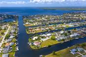 Set your course, South to Cabbage Key for lunch or North to Boca Grande Pass for some fishing? Your choice! - Single Family Home for sale at 145 Leland St Se, Port Charlotte, FL 33952 - MLS Number is D6117438