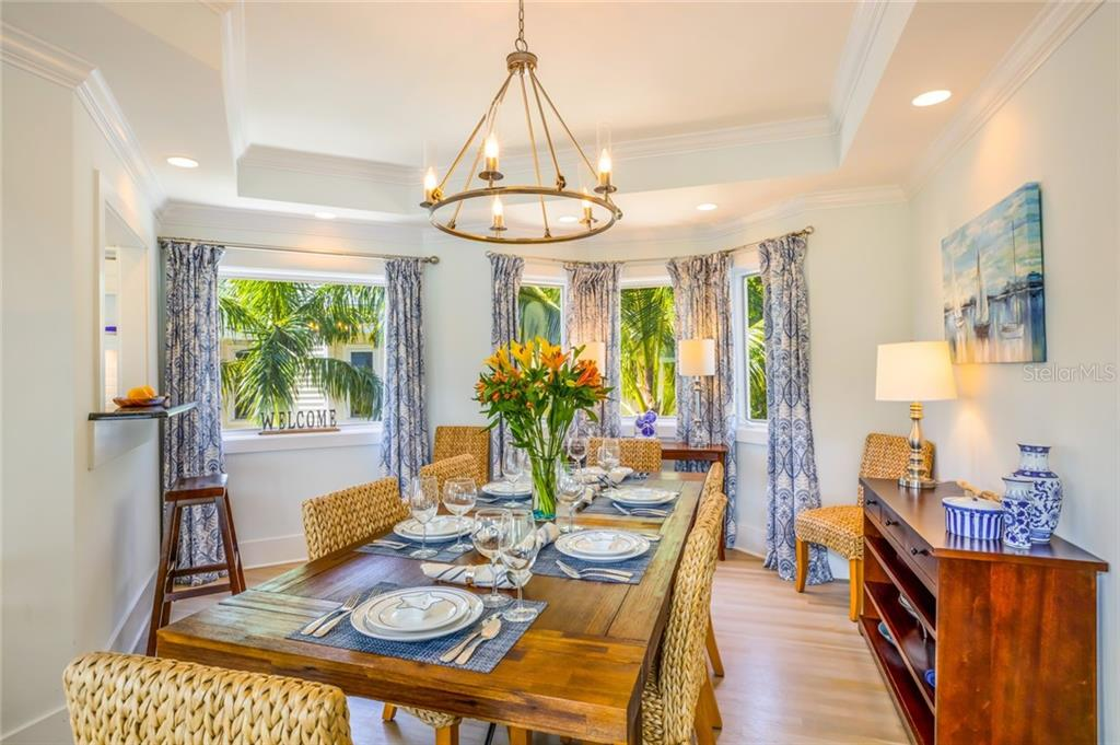 The intimate dining area provides plenty of room for eight or more guests - Single Family Home for sale at 511 Loquat Dr, Anna Maria, FL 34216 - MLS Number is T3196169
