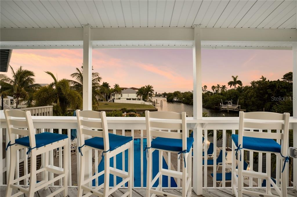 Twilight views from the upper deck - Single Family Home for sale at 511 Loquat Dr, Anna Maria, FL 34216 - MLS Number is T3196169