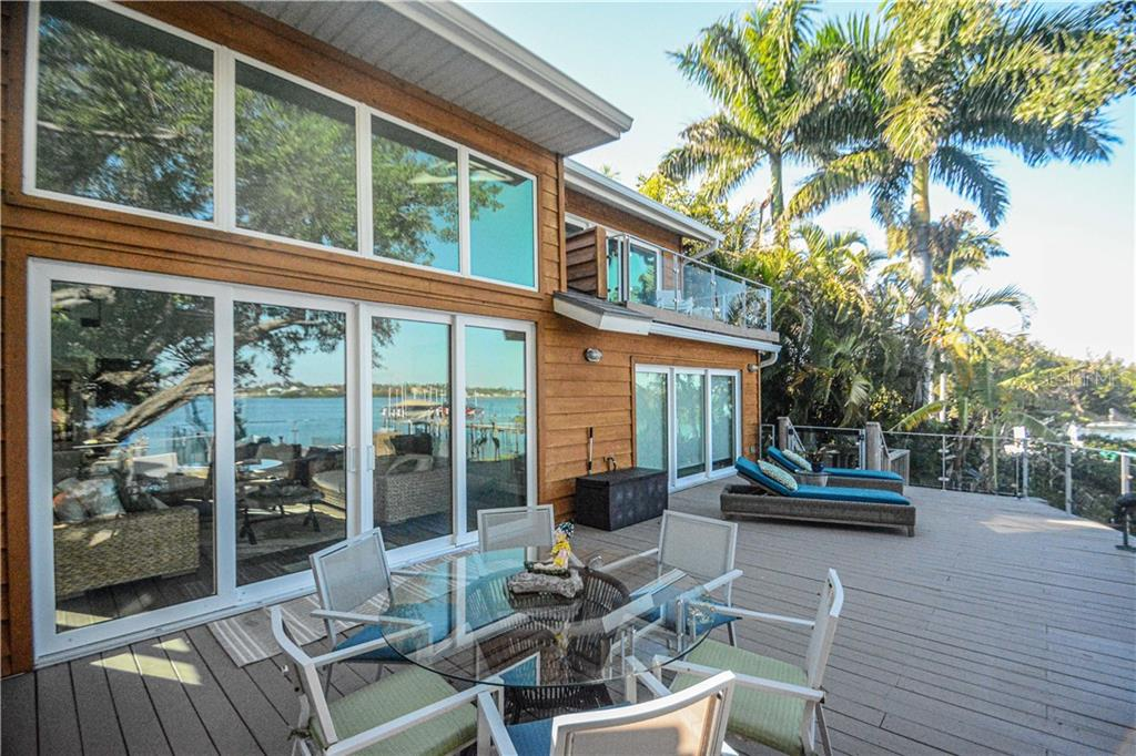 Expansive Deck with Bay views.  Two story vaulted great room. - Single Family Home for sale at 140 N Casey Key Rd, Osprey, FL 34229 - MLS Number is T3228618