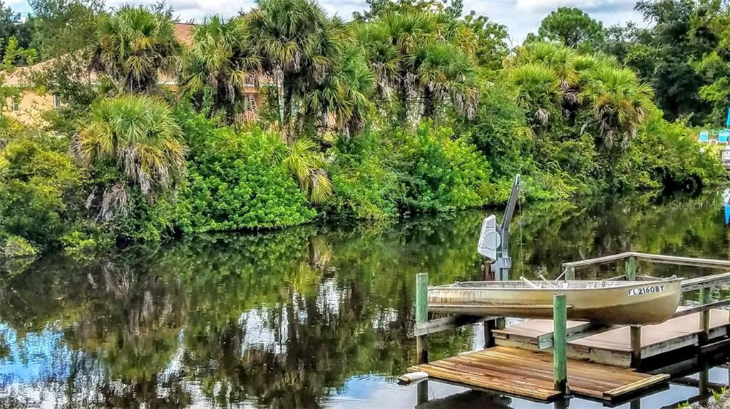 View from across canal to show water frontage - Vacant Land for sale at 2298 Como St, Port Charlotte, FL 33948 - MLS Number is U8017900