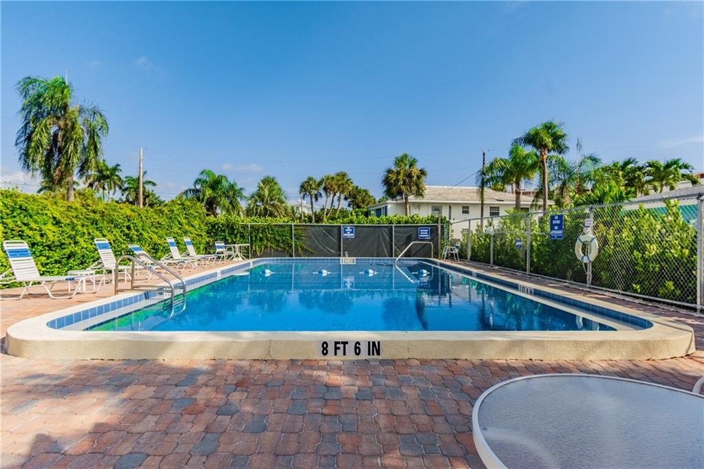 Community swimming pool. - Condo for sale at 5608 Gulf Dr #111, Holmes Beach, FL 34217 - MLS Number is U8093472