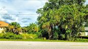 Front of vacant lot abutting Como St. - Vacant Land for sale at 2298 Como St, Port Charlotte, FL 33948 - MLS Number is U8017900