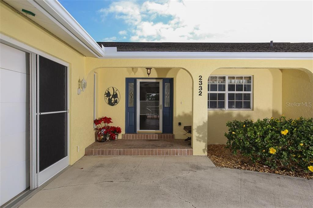 Welcoming covered entry. - Single Family Home for sale at 2332 Mauritania Rd, Punta Gorda, FL 33983 - MLS Number is C7234250