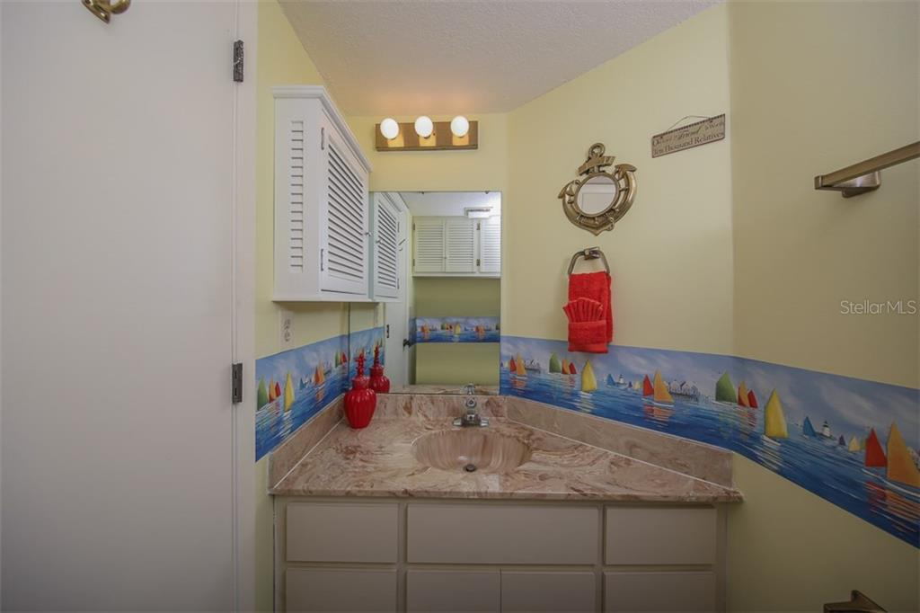 Half bathroom in hallway - Condo for sale at 1765 Jamaica Way #302, Punta Gorda, FL 33950 - MLS Number is C7234643