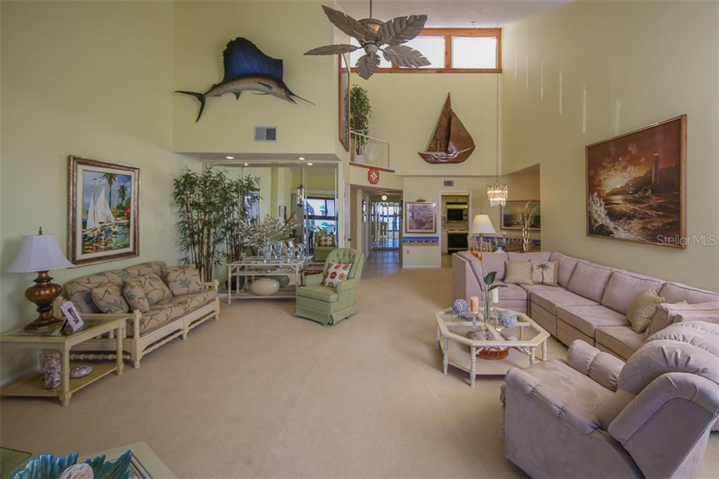 Vaulted ceilings with transom window that brings additional light - Condo for sale at 1765 Jamaica Way #302, Punta Gorda, FL 33950 - MLS Number is C7234643