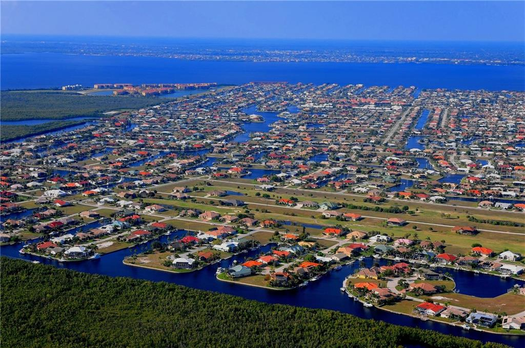 Aerial view of Punta Gorda Isles which is a boater's paradise! - Vacant Land for sale at 3013 Chapman Blvd, Punta Gorda, FL 33950 - MLS Number is C7236430