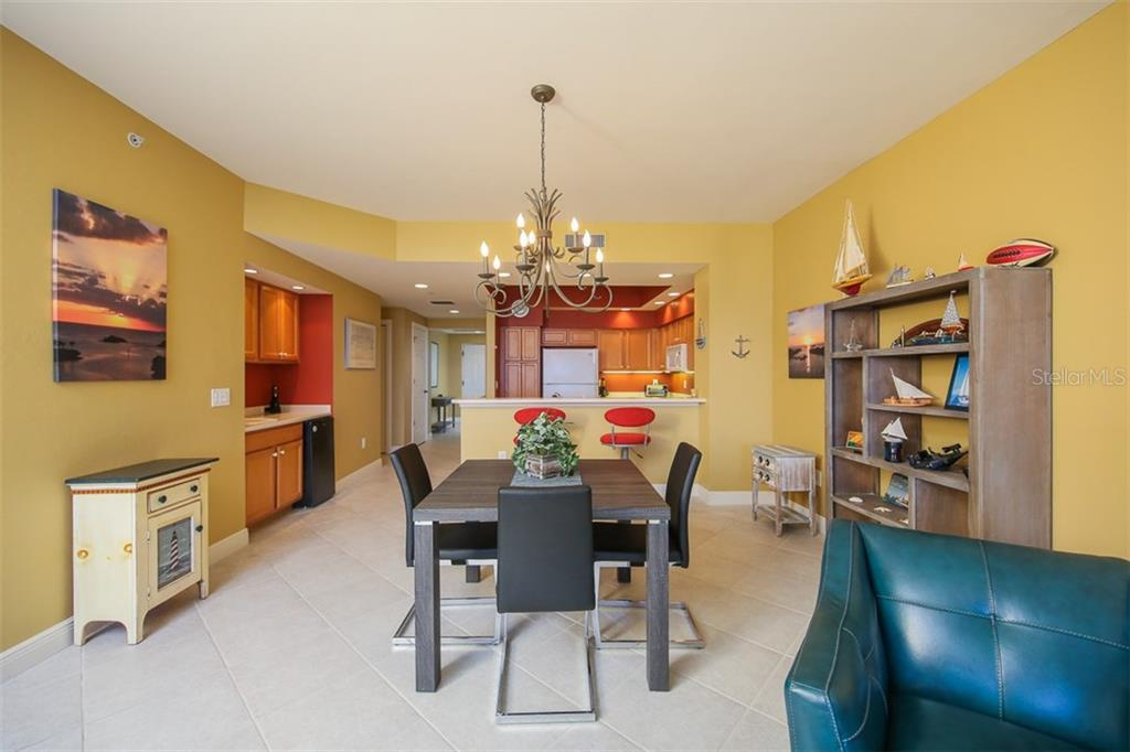 Situated between the great room and kitchen you will find this dining area. - Condo for sale at 3313 Sunset Key Cir #402, Punta Gorda, FL 33955 - MLS Number is C7236886