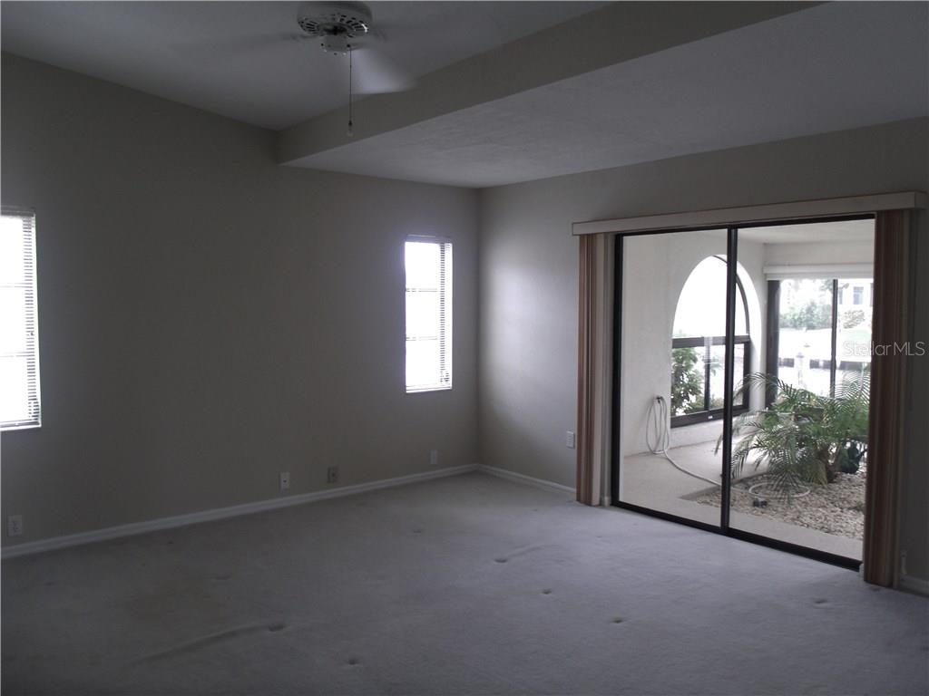 526 square feet of panoramic canal views from this western facing lanai....open space design gives you the ability to have several different types of seating areas.  There is a ductless a/c unit, vinyl windows and a sink with refrigerator and cabinets as well as an interior garden space - Villa for sale at 1890 Deborah Dr #24, Punta Gorda, FL 33950 - MLS Number is C7237753