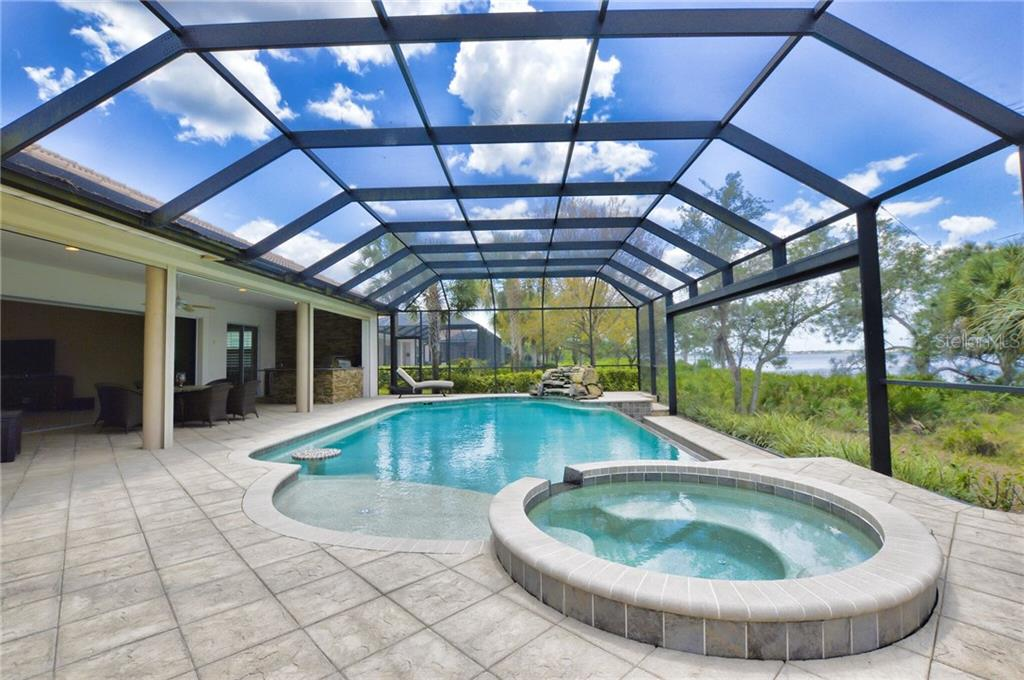 Additional view of your hot tub, waiting pool, in-pool tabletop, waterfall, and spectacular array of lights beaning from your remote control fountain, on your spacious lanai. - Single Family Home for sale at 2839 Mill Creek Rd, Port Charlotte, FL 33953 - MLS Number is C7238545