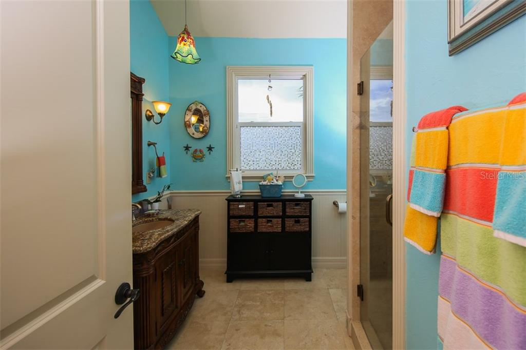 Guest bathroom with wood/granite vanity and walk-in shower - Single Family Home for sale at 17296 Foremost Ln, Port Charlotte, FL 33948 - MLS Number is C7240998